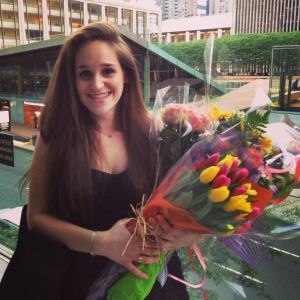 Gaby Aisenberg holds several bouquets of flowers