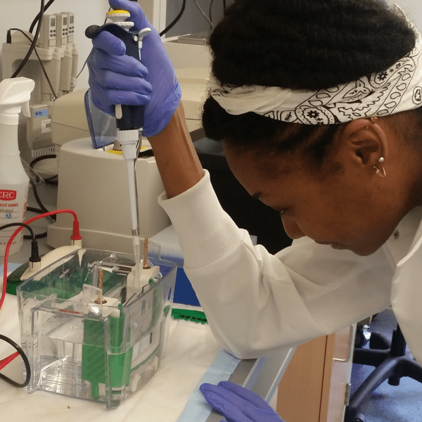 An REU student working in the lab