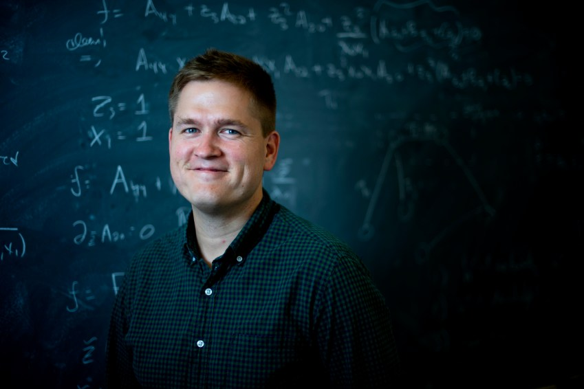 7/22/19 - BOSTON, MA. - James Halverson Assistant Professor of Physics poses for a portrait on July 22, 2019. Photo by Matthew Modoono/Northeastern University