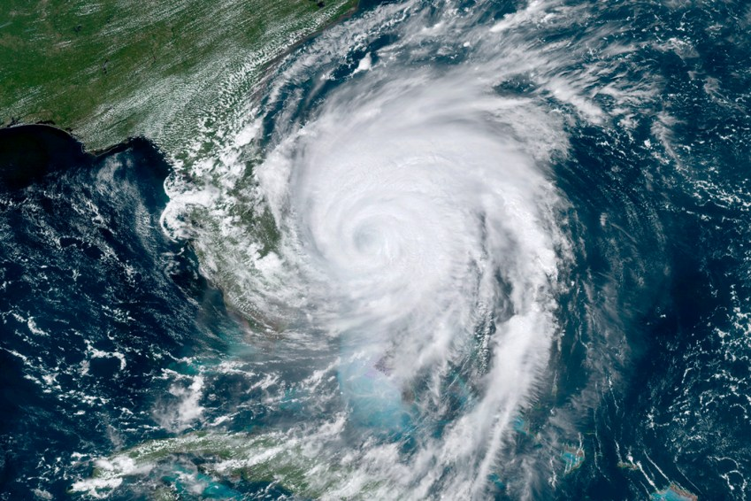 This GOES-16, GeoColor satellite image taken Tuesday, Sept. 3, 2019, at 17:10 UTC and provided by National Oceanic and Atmospheric Administration (NOAA), shows Hurricane Dorian moving off the east coast of Florida in the Atlantic Ocean. (NOAA via AP)