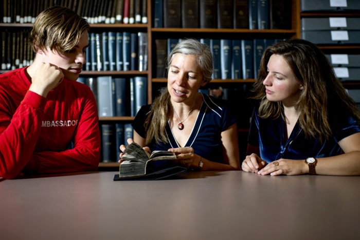 09/09/19 - BOSTON, MA. - Professor Erika Boeckeler looks at the Dragon Prayer Book, Northeastern's medieval manuscript, with students Connor Hamill and Laura Packard in the Snell Library archives on Sept. 9, 2019. Photo by Matthew Modoono/Northeastern University