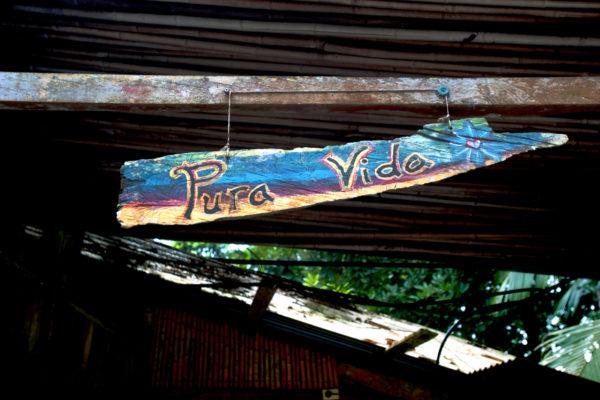 "A ""Pute Vida"" sign hangs at VerdEnergia. Photo by Hiroko Tanaka for Northeastern University."
