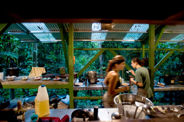 Olivia Ahner, left, environment engineering major intern, and Javier Gallardo, local intern and ecotourism student of University of Costa Rica, prepare dinner in the kitchen. During the stay at VerdEnergia, interns take turns to cook meals for everybody.