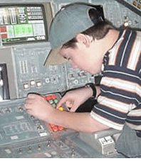 Boy feeling button on space consol