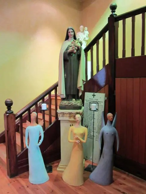 A statue of the Virgin Mary and three other female statues.