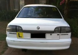 Car with L-plates.