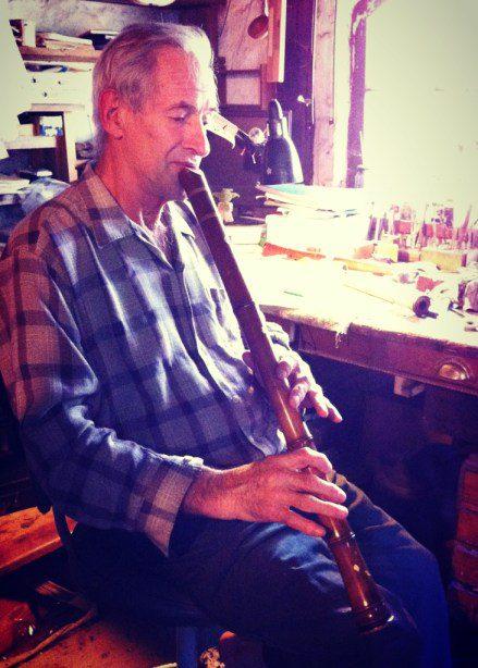 Montsalvat Artist David Brown playing a flute.