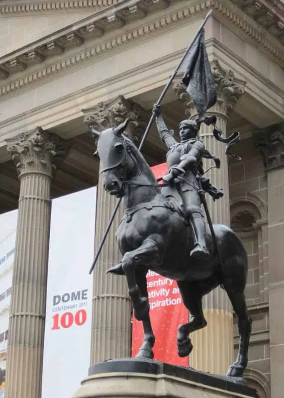 A statue outside the State Library of Victoria.