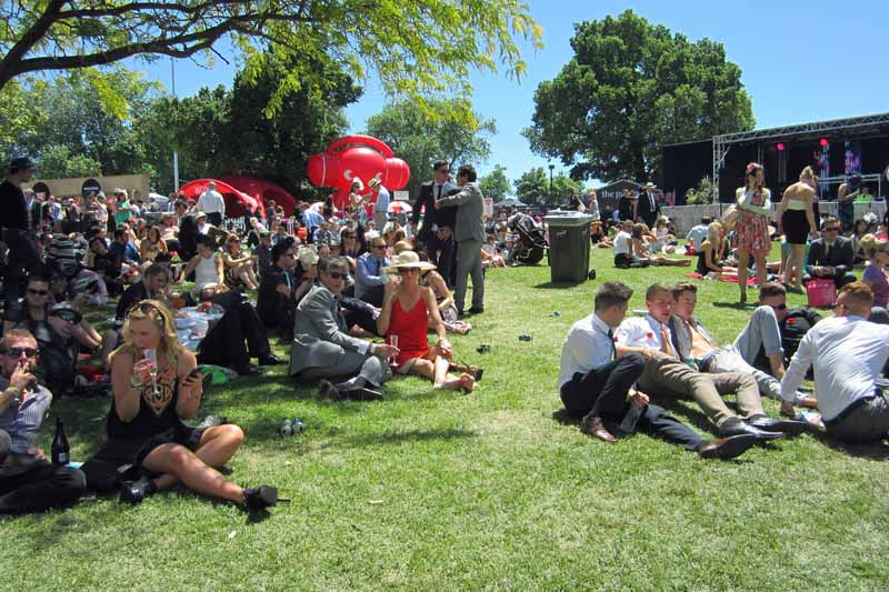 Racegoers relaxing on the hill.