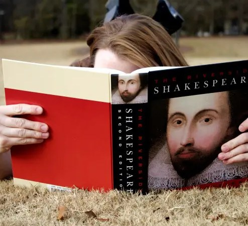 A woman reading the Riverside Shakespeare, a book I left behind.