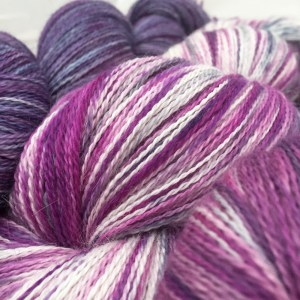 Speckled Yarn and purple variegated lace weight yarn