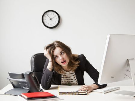 woman-stressed-at-work-w724