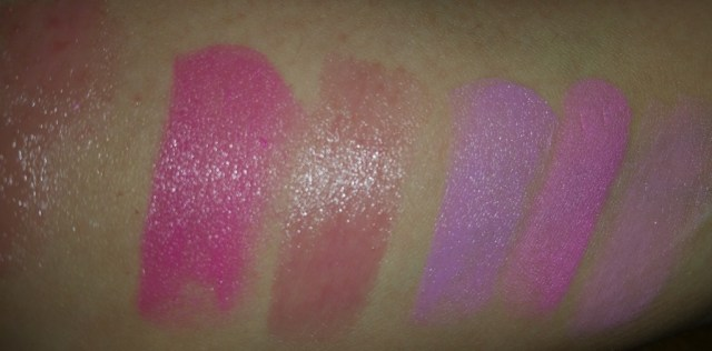 Swatches left to right: Dior Addict Lip Glow - Lilac 005, NYX Butter Lipstick - Razzle Fiesta, Cover Girl Oh Sugar! - Jelly 9, Maybelline Colorsensational Lilac Flush 725, Wet N Wild Lipstick - Dollhouse Pink 967, and Essence Longlasting Lipstick - Get the Look 20.