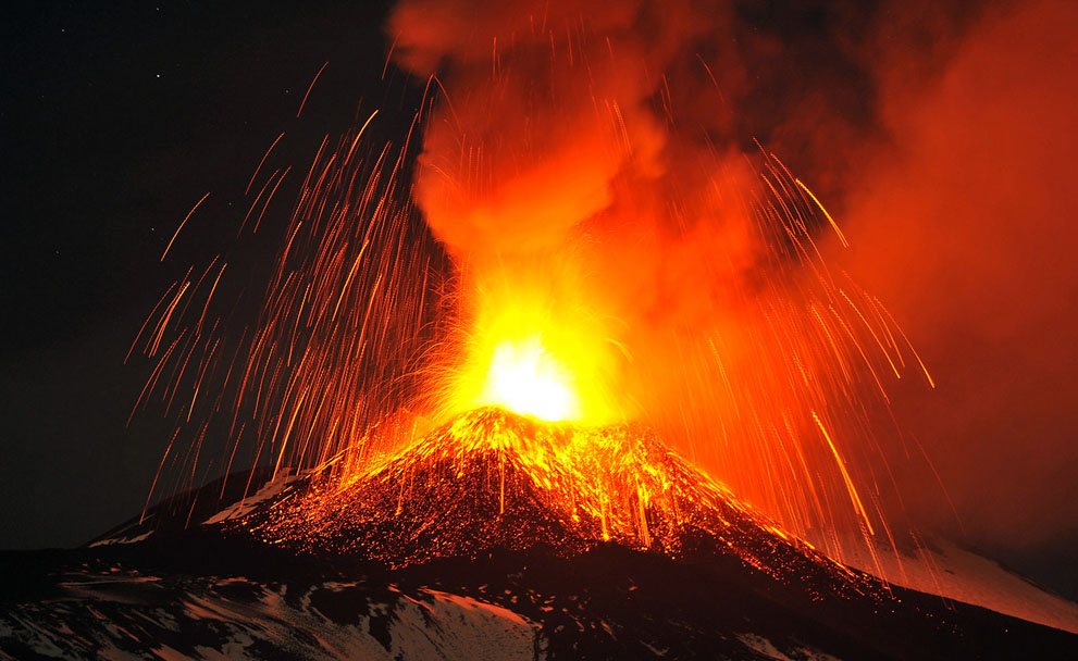 Mt. Etna, Europe's most active volcano, spews lava during an eruption as seen from Acireale, near the Sicilian town of Catania, Italy, on November 16, 2013. (AP Photo/Carmelo Imbesi)