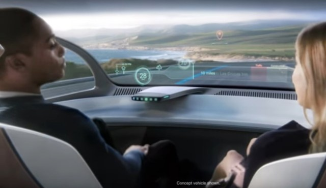 An artist's conception shows a Ford autonomous vehicle that has a heads-up display, but no steering wheel. (Ford via YouTube)