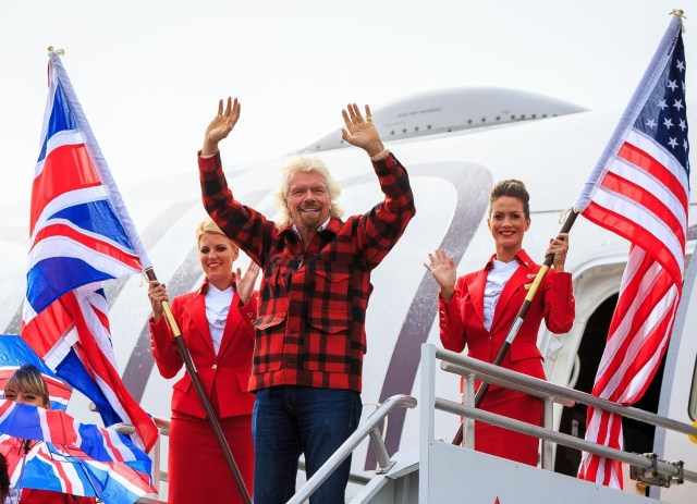 Richard Branson and flight attendants at Sea-Tac