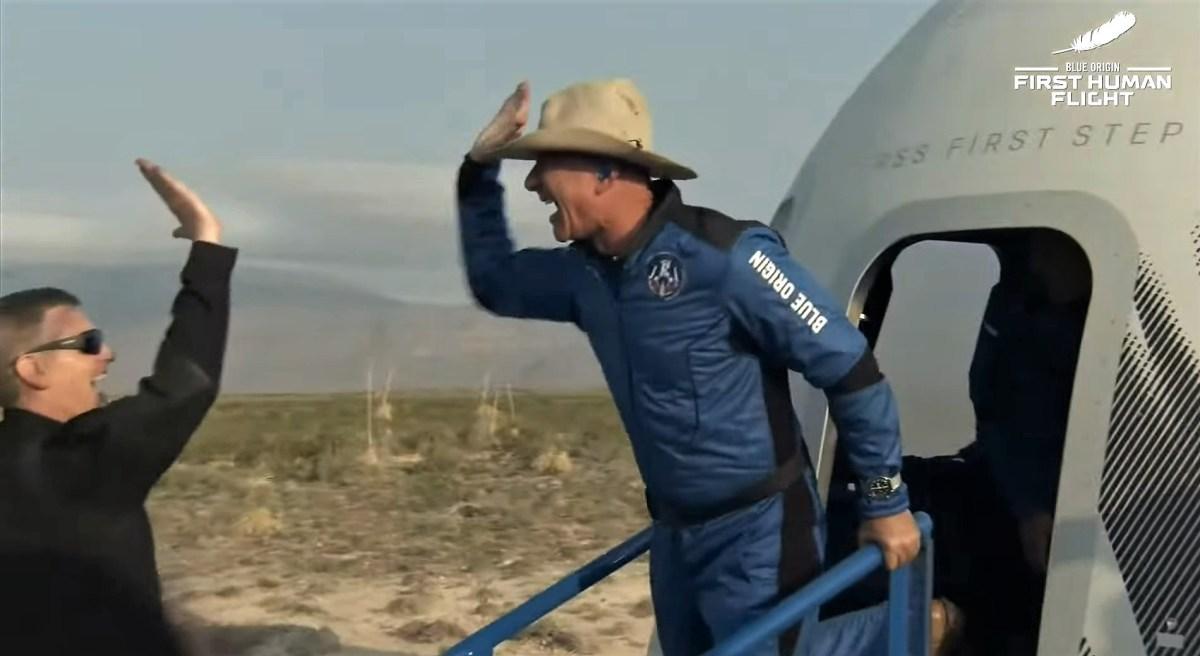 Jeff Bezos gives high-five
