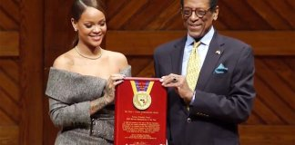 rihanna receiving award for charity
