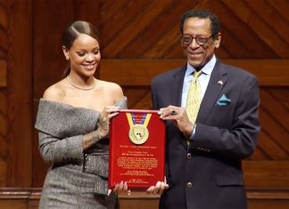 rihanna receiving award for charity