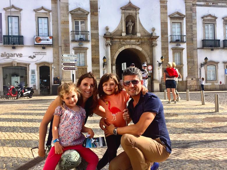 CosmopoliClan family picture in front of Faro's historic town