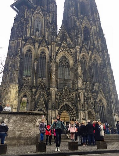 CosmopoliClan posing in front of the Cologne Cathedral in Germany