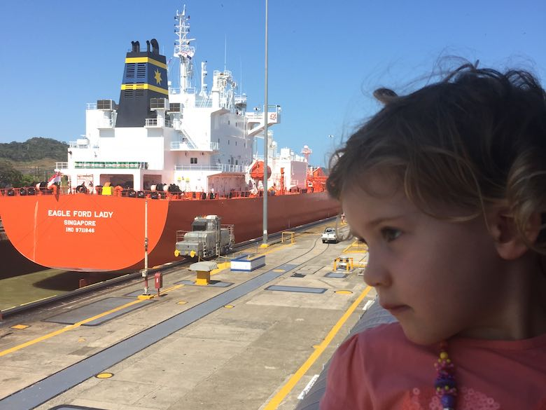 Jade looking at a large vessel that just passed the Miraflores docks