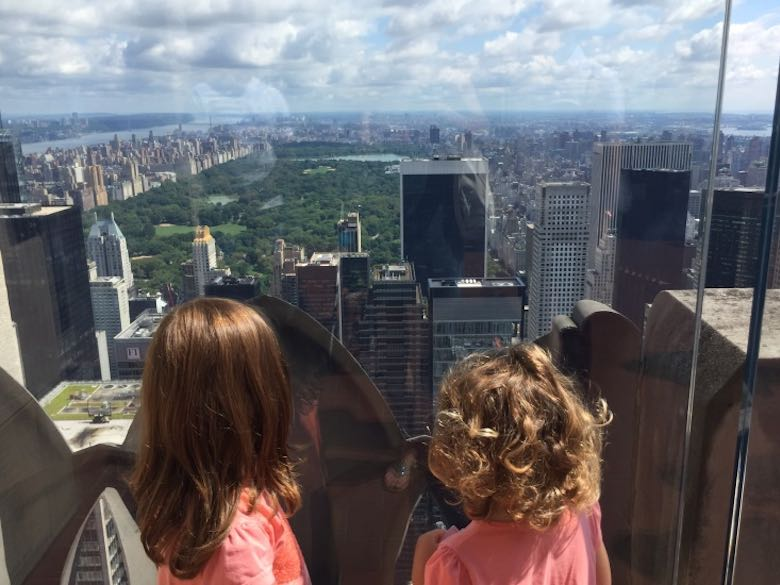 Two little girls overlooking Central Park and the Manhattan Skyline from Top of the Rock in NYC