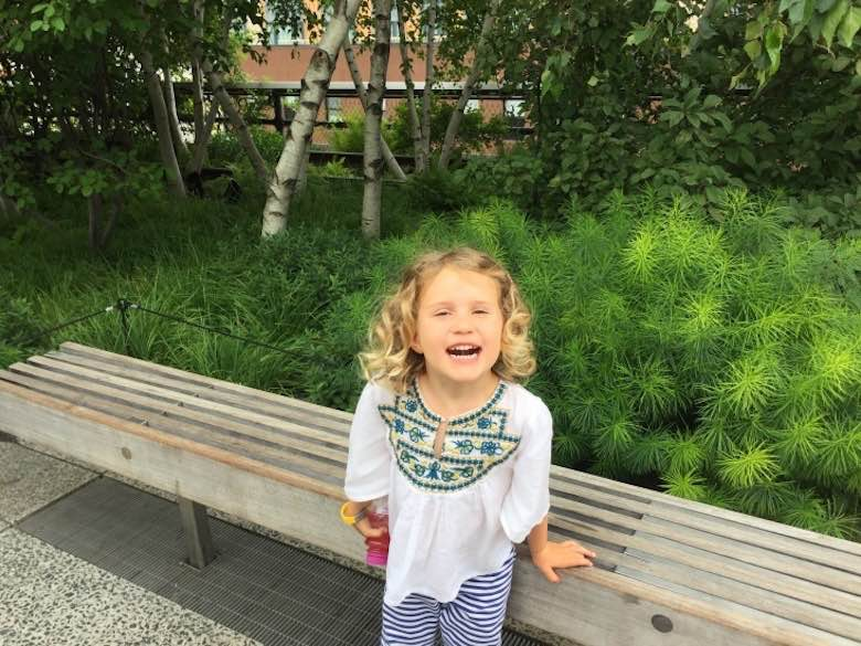 """CosmopoliClan""""s little girl laughing out loud on the Highline in NYC"""