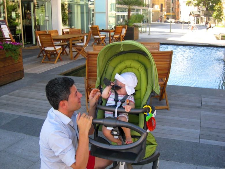 Dad and his baby girl exchanging sunglasses at a terrace in sunny Italian Savona