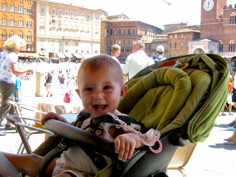 Little baby girl enjoying the view at the Piazza del Campo in Siena