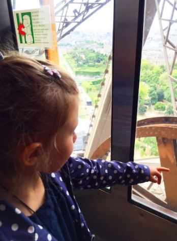Little girl in one of the elevators of the Eiffel tower, an ideal way to make a little girl love Paris