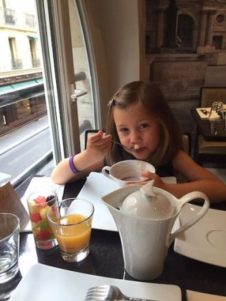 Little girl who fell in love with Paris is enjoying a healthy breakfast