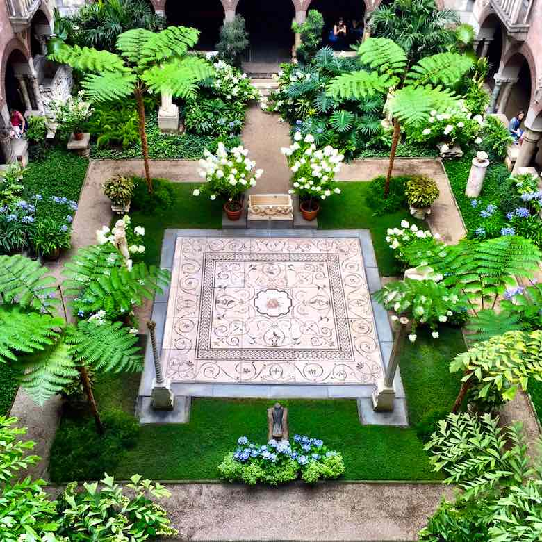A view of the stunning green courtyard of the Isabella Stewart Gardner museum, taken from the balcony