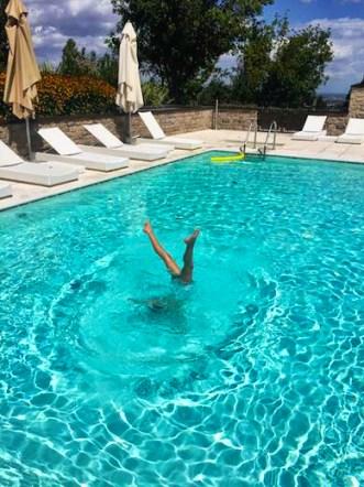 Handstand in the children's pool in Palazzo di Varignana Resort & Spa near Bologna