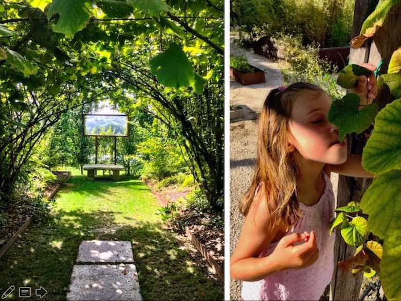 The enchanting garden in the Palazzo di Varignana Resort & Spa with a little girl eating grapes straight from the vine