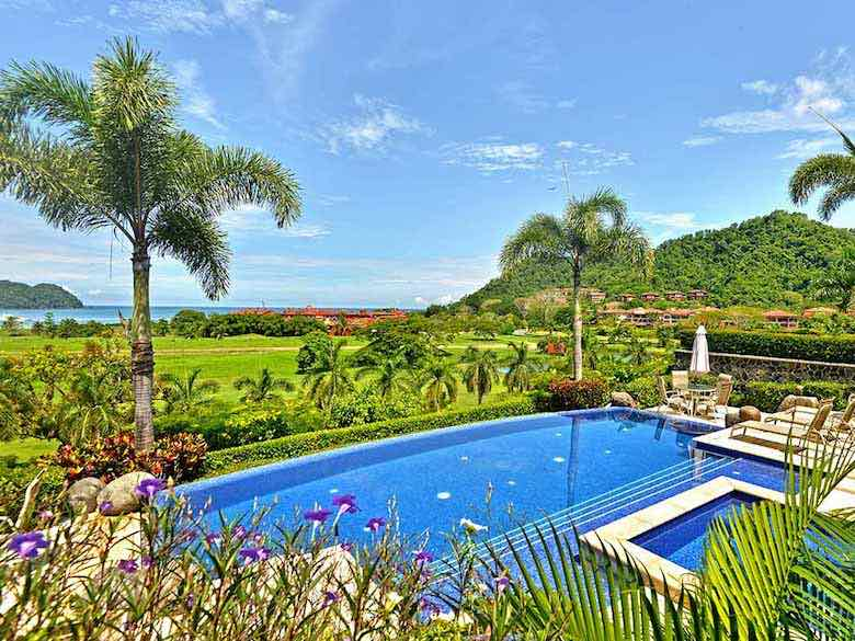 View of the pool, tropical garden and panorama from Villa Tranquila in Costa Rica, available via Luxury Retreats
