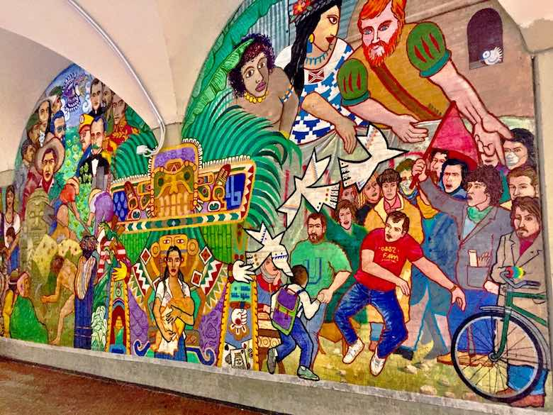 Colorful street art, representing the history of South-America, in the Via Zamboni in vibrant Bologna, Italy