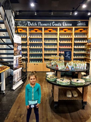 Little girl in a cheese shop during a mother-daughter trip to Amsterdam