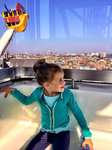 Jade high up on the giant wheel overlooking the city of Amsterdam while a spectacular red and yellow attraction swings by