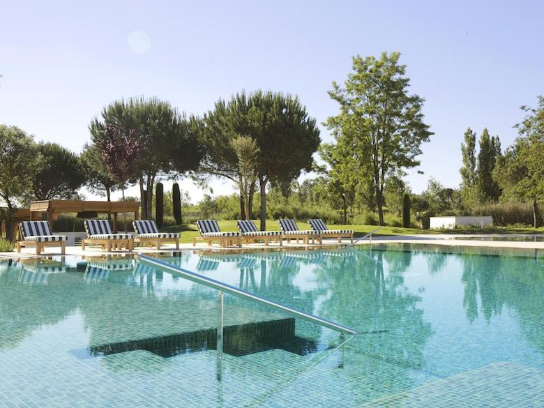 Pool view of Hotel Camiral, Spain, featured in this article with family-friendly luxury resorts in the Mediterranean