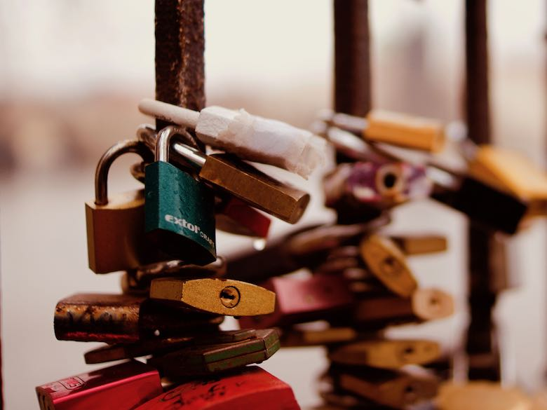 Locks in different sizes, colors and shapes to show how important it is to protect your online identity while traveling