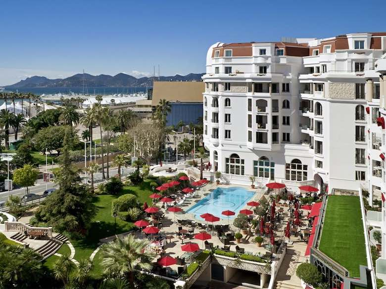 Aerial view of the Hotel Barriere Le Majestic in Cannes, France, featured in this article with family-friendly luxury hotels in the Mediterranean