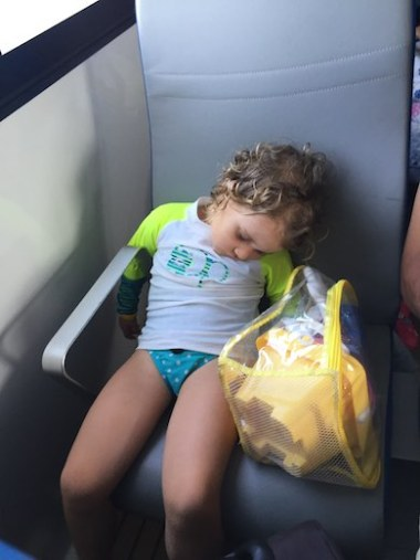 Little girl sound asleep in the ferry from Isla Contadora, the ultimate one-day beach getaway from Panama City