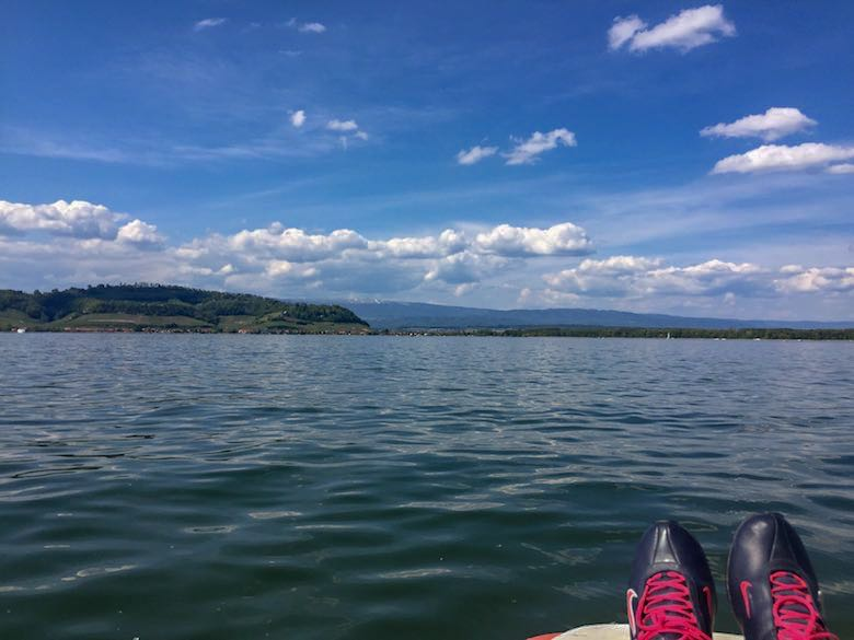 Athletic shoes on a paddle boat on lake Murten or lac Morat in Switzerland