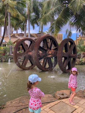 Two little girls exploring Maui Tropical Plantation