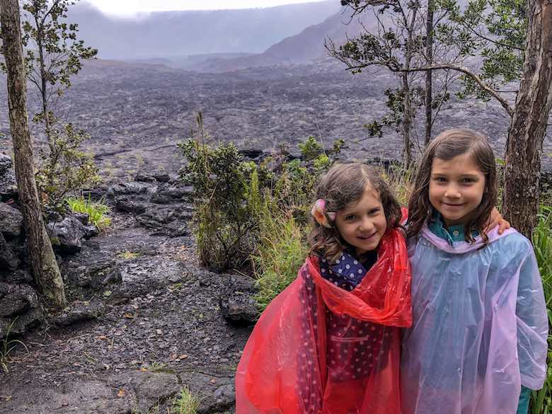 Two little girl posing during a hike of the Kilauea Iki Trail in Hawaii Volcanoes National Park
