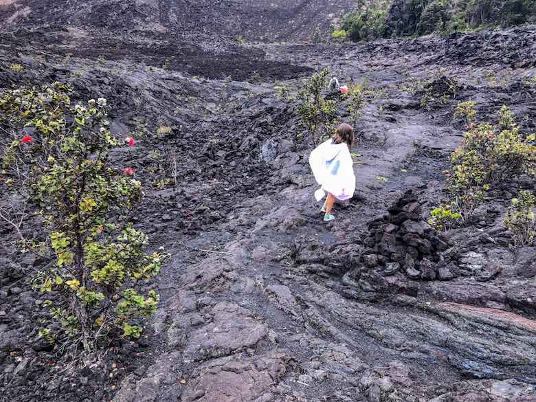 Hiking through black lava fields on the Kilauea Iki Trail, the best Big Island hike
