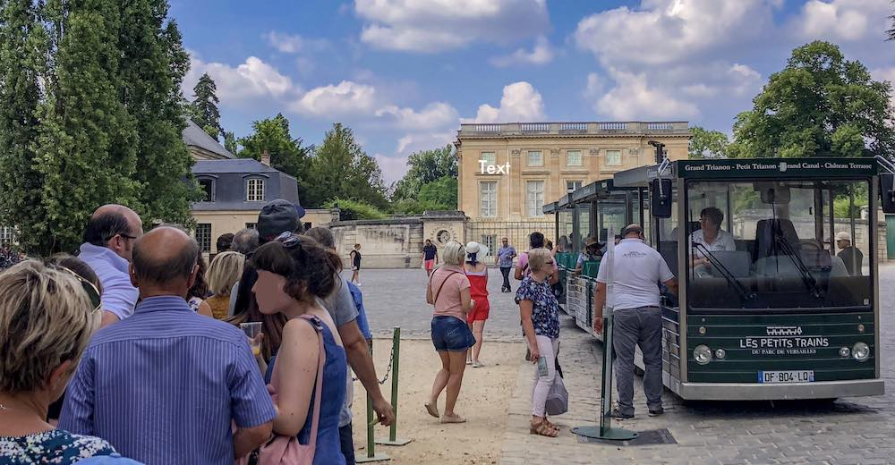 Little train with stops at the Versailles Palace, the Gardens of Versailles and the Petit Trianon