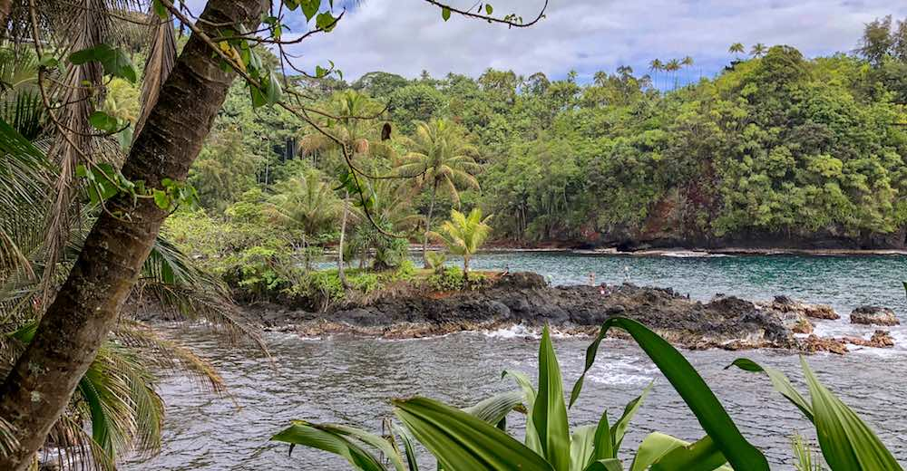 Gorgeous blue waters of Onomea Bay in Hilo Hawaii as seen from the Hawaii Tropical Botanical Gardens
