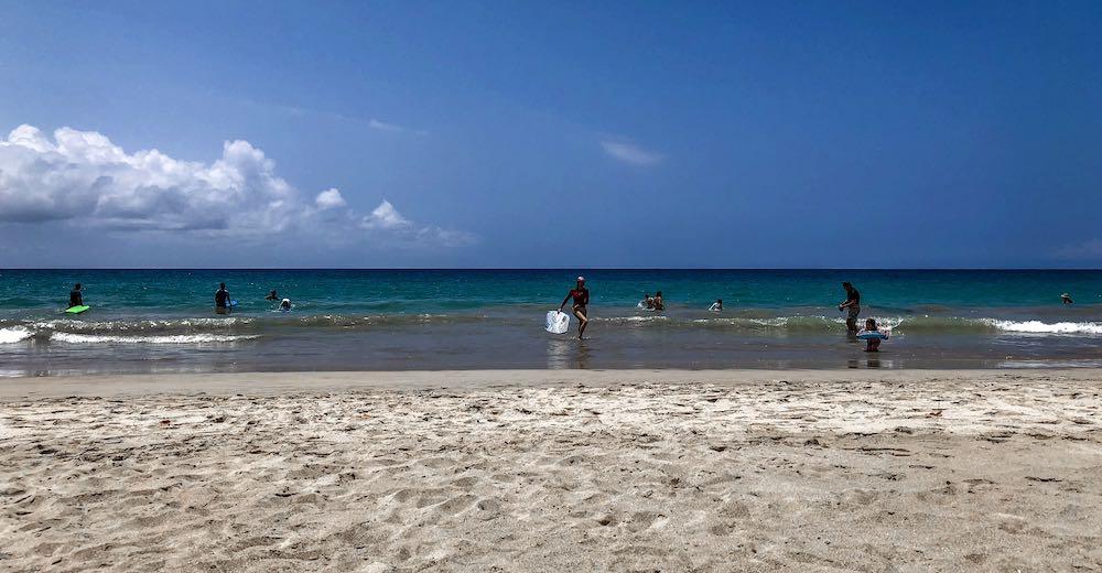 CosmopoliMom boogieboarding Hapuna Beach, one of the best Hawaii Big Island beaches